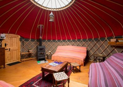 Interior of our yurt with woodstove